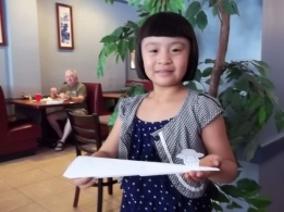 LJ WITH PAPER AIRPLANE